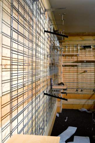 Empty racks, hangers and shelves were cleared out of the mountain retailer's former space.