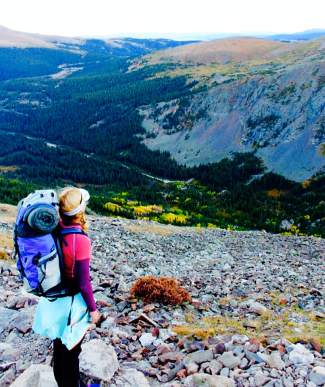 At dusk, Shawna Henderson takes in the view south of Quandary Peak on her first overnight 14er excursion.