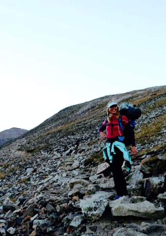 Shawna Henderson loaded down with sleeping gear for an overnight 14er trip at Quandary Peak.