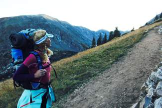 Shawna Henderson takes a break on the Quandary Peak trail as the sun sets behind the western slopes of the mountain.