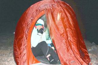 Shawna Henderson in her tent on top of Quandary Peak.