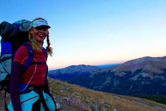Shawna Henderson breaks for the alpenglow during her first overnight ascent of Quandary Peak.