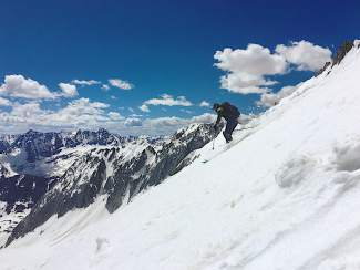 Jon Kedrowski skies down Snowmass Peak under bluebird skies on June 5.