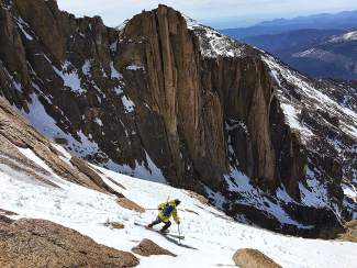 Vail mountaineer Jon Kedrowski skis down Longs Peak earlier this year on his quest to climb and ski Colorado's 14,000-foot peaks in one season.