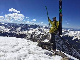 Jon Kedrowski celebrates at the summit of Snowmass Peak earlier this month as he neared the end of his effort to ski and climb the big peaks of Colorado.