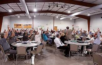 AKRON, CO-July 08, 2013: Almost everyone in the room, at Washington County fairgrounds, raised their hand when asked if they felt if their needs were being ignore by the Colorado State Legislature during a public meeting to talk about the idea of forming the 51st state, July 08, 2013. The proposal comes after many attending the meeting feel that the State Legislature continues to ignore the needs of rural Colorado. (Photo By RJ Sangosti/The Denver Post)