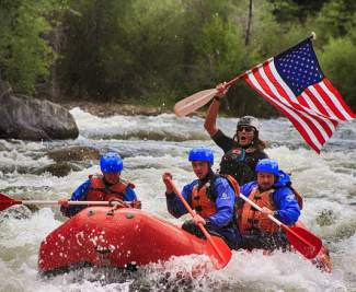 Paddling with patriots. Submitted via Instagram by user @performancetoursrafting using #ExploreSummit.