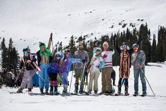 A group of costumed skiers and snowboarders show off their duds (and skin) at the top of Arapahoe Basin on May 14. The ski area recently extended its season for a bonus weekend, June 10-12.