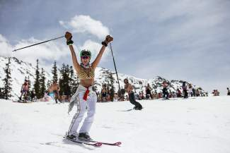 A skier celebrates May skiing the Colorado way: with a swimsuit parade at Arapahoe Basin on May 21. The ski area recently announced it's extending the season for a final weekend, June 10-12.