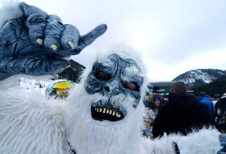 Nick Cooke, aka the abominable snowman, waits in line at Black Mountain Express lift for early-season turns on Halloween. Arapahoe Basin drew rouhgly 2,000 skiers and snowboarders for the first weekend day of the season, including hundreds of costumed riders.