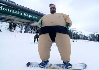 James Tarras, of Denver, brought the sumo suit to Arapahoe Basin for Halloween turns.