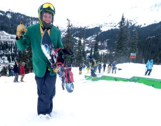 Summit local Ian Smith treks up the terrain park in full Halloween regalia between laps at Arapahoe Basin.
