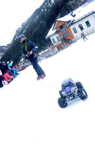 Costumes weren't the only thing on the snow at Arapahoe Basin for Halloween. A young skier plays around with an RC car between laps.