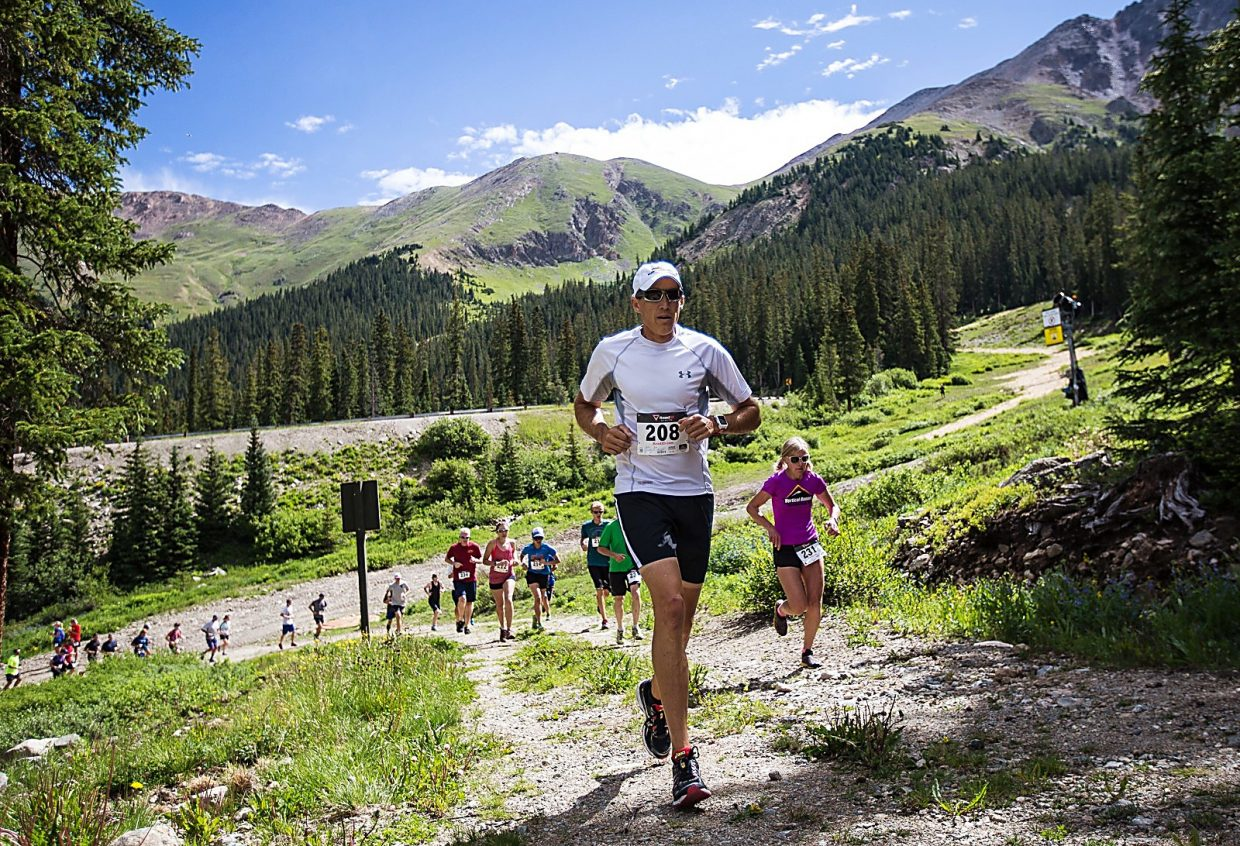Runners tackle the first incine after leaving the base area at Arapahoe Basin during the 2015 Summit Challenge trail run. The event returns to A-Basin on Aug. 21 with a 1.8-mile option and 4.6-mile option.