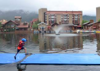 A young adventure racer runs across the pond crossing obstacle during the Copper Family Adventure Quest on July 2. The first-annual event drew more than 80 two-person teams for a pint-sized adventure race across Copper Mountain.