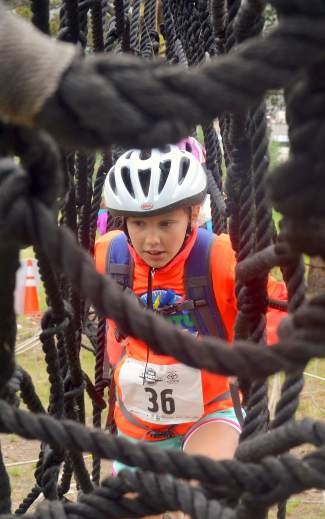 A young racer picks her way through the rope net obstacle during the first-annual Copper Family Adventure Quest on July 2.