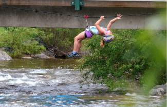 A young racer hangs suspended over a creek in Copper Center Village during the first-annual Copper Family Adventure Quest on July 2.