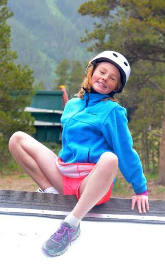 All smiles: A racer poses for the camera while waiting for her team during the first-annual Copper Family Adventure Quest on July 2.