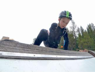 A young racer climbs up and over the slick wall obstacle during the first-annual Copper Family Adventure Quest on July 2.
