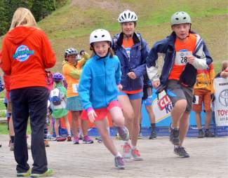 A group of racers speeds away from the start line at the Copper Family Adventure Quest on July 2.