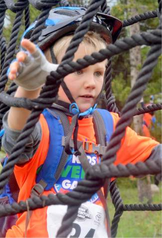 A young racer weaves through the net obstacle at the first-annual Copper Family Adventure Quest on July 2.