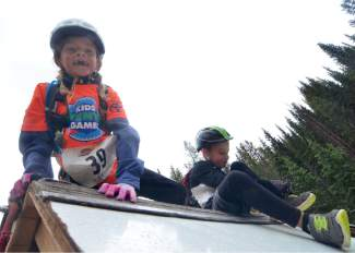 Two young racers rest on top of the slick wall obstacle during the first-annual Copper Family Adventure Quest on July 2.
