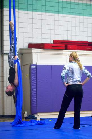 The author watches instructor Rachel Miller demonstrate an inversion on aerial silk at the Breckenridge Recreation Center in January.
