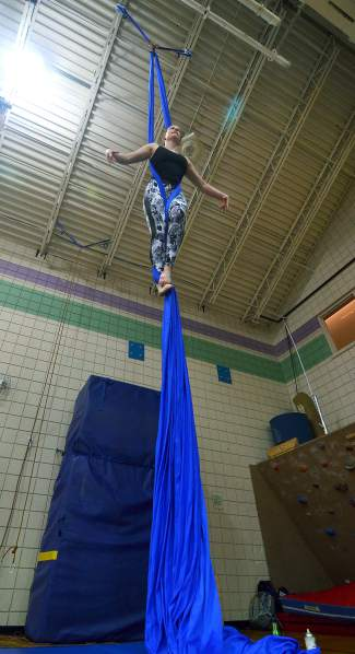 Aerial silk instructor Rachel Miller demonstrates hands-free movements during an intro course at the Breckenridge Recreation Center in January.