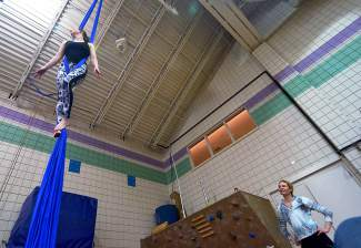 Aerial silk instructor Rachel Miller gives tips on elevated movements as the author looks on during an intro course at the Breckenridge Recreation Center.