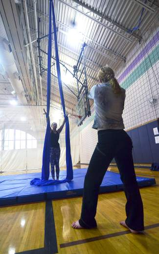 Aerial silk instructor Rachel Miller (facing) gives the author tips on how to work with the floor-to-ceiling silk sheets during an intro course at the Breckenridge Recreation Center.
