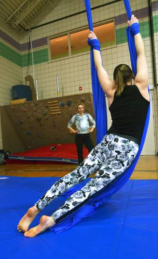 Aerial silk instructor Rachel Miller (front, facing away) gives the author a rundown of the basics before passing over the silk at the Breckenridge Recreation Center in January.