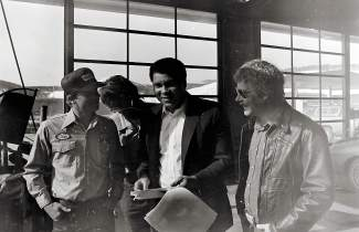 Muhammad Ali i conversing with Silverthorne Chevron staff and a customer in 1983. His car had broken down and was forced to stop in town.