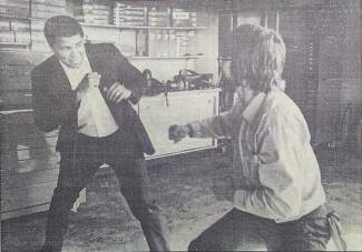 In this news story photo clipping from 1983, Muhammad Ali spars playfully with mechanic Keith Bouma at a Silverthorne gas station while awaiting car repair.