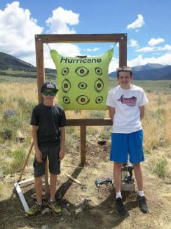Zach Elsass, right, 14, of Breckenridge, stands with Connor Albin, 12, next to target stands Elsass built for the county archery range for his Eagle Scout project. He will finish installing them with the help of volunteers Saturday, Aug. 9.