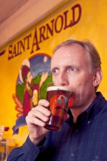 Saint Arnold Brewing Co. founder and brewer Brock Wagner enjoys the spoils of his labor at his downtown Houston tasting room. In September Colorado beer drinkers will receive their first taste of Texas' oldest craft brewery as Saint Arnold expands into the Front Range market.