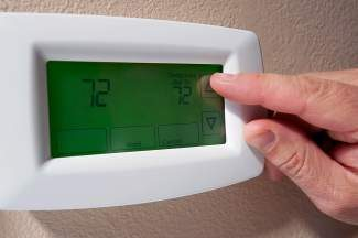 Changing the temperature on a digital thermostat