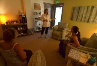Andi Sigler of Vive Float Studio in Frisco talks with clients inside the quiet room. The private space, found just past the main lobby with access to the float rooms, features low lights and plush chairs for clients to relax before or after a float session.
