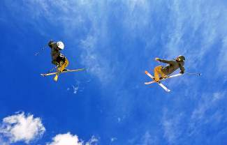 Kiernan (left) and Deven Fagan, 14-year-old twins from Maine now training in Summit County, throw synchronized cork 720s on jump six of the Park Lane jump line at Breckenridge on March 22. The two have no coach and instead rely on each other to progress on the youth freeski circuit.
