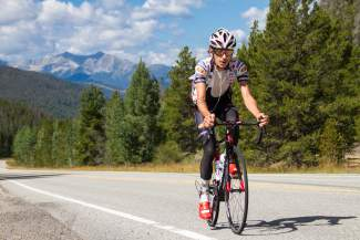 Australian cyclist Lachlan Morton (Jelly Belly-Maxxis) pedals between Keystone and Arapahoe Basin on a training run before the USA Pro Challenge. This year's race marks the debut of the Category 2 climb, the first half of the grueling Loveland Pass ascent.