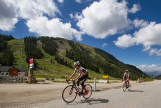 Australian brothers Lachlan (front) and Angus Morton pedal past The Beach at Arapahoe Basin during a training ride before the USA Pro Challenge. A-Basin hosts its first-ever finish for the multi-day stage race on Aug. 18.