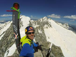 Chris Davenport at the summit of Hagerman Peak (13,841 feet) before skiing to the base on June 6, 2013.