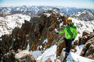 Aspen-based freeskier Chris Davenport at the summit of Jupiter Peak (13,830 feet) before skiing down Colorado's 92nd highest peak for the Centennial Peaks project.