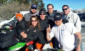 Leadville adaptive snocross racer Billy Burkhardt (center) at the 2016 X Game Aspen with his race crew, a collection of friends and family including his ex-wife, pro snowmobile racer Oksana Burkhardt (second from right).