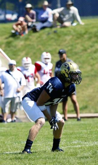 Summit local Andrew Ike waits for the snap at a Fort Lewis College football game in fall 2015. Ike made the first team Rocky Mountain Athletic Conference this season for a breakout year playing linebacker — his first ever.