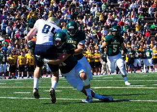 Summit local Andrew Ike (85) of Fort Lewis College gets tackled by a Black Hills State University player during an away game this fall. About halfway through the season, Ike switched from wide receiver to linebacker and was selected to the first team Rocky Mountain Athletic Conference.