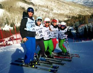 Loveland Ski Club alpine coach Gunnar Sorensen (left) with a group of his youth athletes at a recent race. Sorensen works with the club's Academy program, a year-round training program with 11 youth athletes from across Colorado and the country.