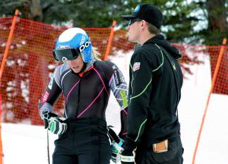 Gunnar Sorensen (right) with U.S. Ski Team slalom specialist Paula Moltzan. Sorensen spent a season with the World Cup women's team as a tech before moving to ski club coaching.