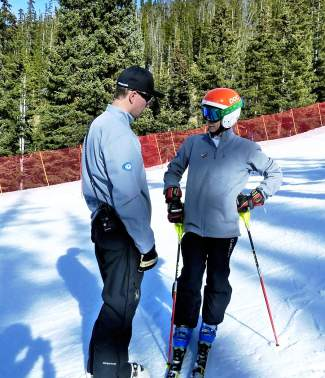 Loveland Ski Club coach Gunnar Sorensen talks with an athlete at a recent race. Sorensen works with U-10, U-12 and U-14 racers and keeps a close log of results to track progress of the season and years.