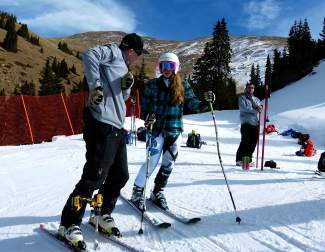 Loveland Ski Club coach Gunnar Sorensen on the hill with one of his athletes. Sorensen is in his eighth year with the club.
