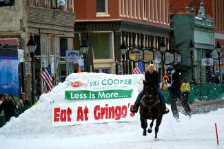 Fairplay's Jesslyn Swirka (on horse) barrels through downtown Leadville on Harrison Avenue with a skier in tow during last year's skijoring contest. Swirka returns to the skijoring scene this weekend with three horses in the Minturn contest, beginning at noon on Saturday and Sunday.